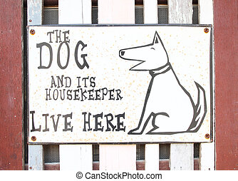 the dog house sign on wood background