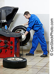 repairman mechanic at wheel balancing - mechanic repairman...