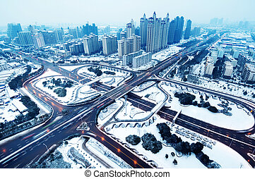 Modern urban freeway - Snow, Aerial modern city highway and...