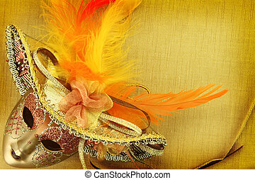 Vintage carnival mask on yellow background