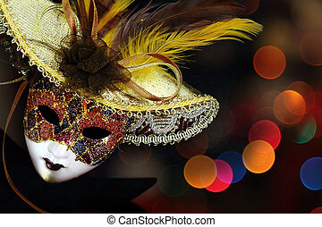 Vintage carnival mask in front of lights background