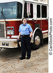 Fire Fighting Female - Attractive woman fire fighter stands...
