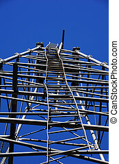 Crooked and Bent - Crooked, bent ladder ascends into the...