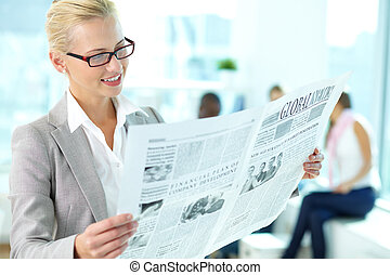 Woman with newspaper - Portrait of happy female reading...