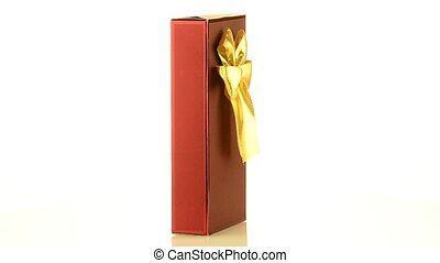 Red box with gold bow on white background