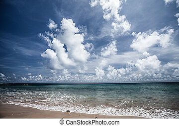 Transparent sea water and blue sky with clouds HDR image