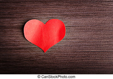 Valentine's Day background. red heart on a wooden background...