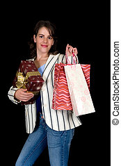 Happy young woman shopping - Happy young woman with shopping...