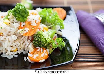 risotto with steamed vegetables, healthy eating close up