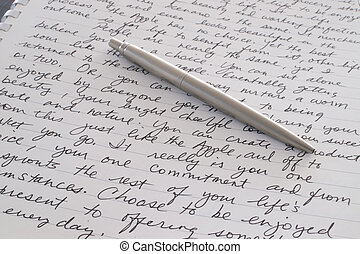 Stainless Steel Pen Laying on Written Page - A Stainless...
