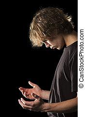 joven, hombre, oración, cupped, Manos