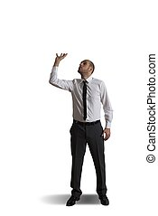 Business man holding something heavy above head