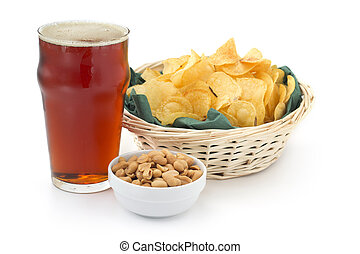 pint of red beer peanuts and chips on white background