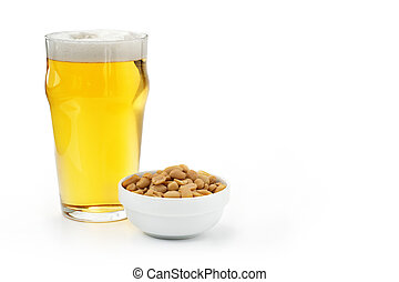 pint of lager and peanuts  on white background