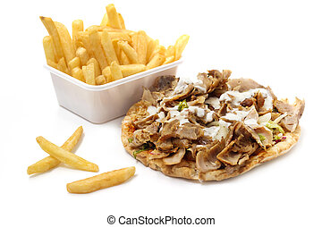 kebab with yogurt sauce and basket of fries on white background