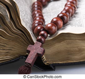 old holy bible and rosary beads