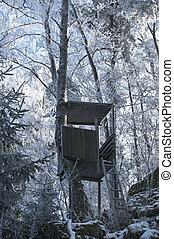 Hunting Tower in Winter Forest