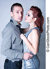 Sensual couple on gray - Studio portrait on gray of sensual...