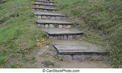 retro stair woman climb - retro wooden stone stair in nature...