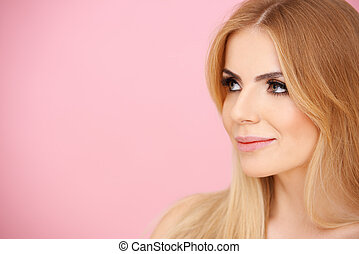Pretty blond girl over pink with copyspace