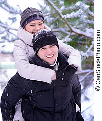 Young Beautiful Couple Taking Fun and Smiling Outdoors in Snowy Winter