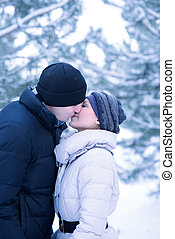 Portrait of a Young Beautiful Couple Kissing Outdoors in Winter