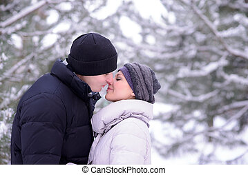 Portrait of a Young Beautiful Couple Kissing Outdoors in...