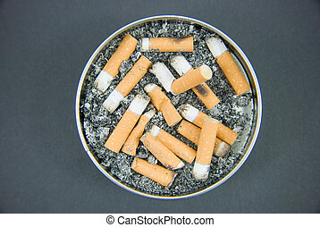 Ashtray - An ashtray with cigarettes and ash