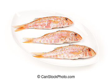Three Red Mullets seafood on a white oval dish