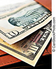 Ten 10 dollar bills cash - on a wallet - close up macro...