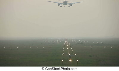 Landing in the mist. - Jet airliner landing in the thick...