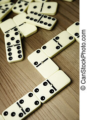 Domino pieces - Close up of dominowith black dots on wooden...