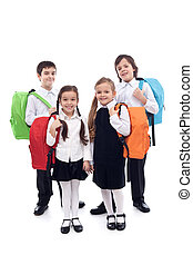 Happy school kids with colorful bags