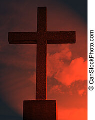 Religious Cross - A religious cross shot against a red sky