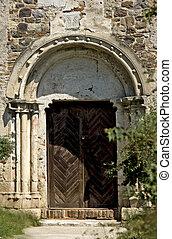 ancient door - Ancient door of a medieval church