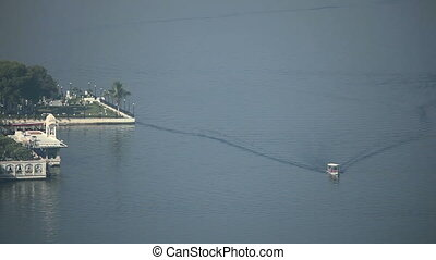 Lakeview. - Small boat moving past the hotel on the lakein...