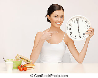 woman with big clock - picture of beautiful woman with big...