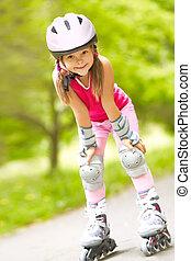 girl on roller skates - Little girl in roller skates at a...
