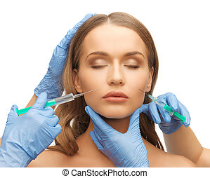 woman face and beautician hands - picture of woman face and...