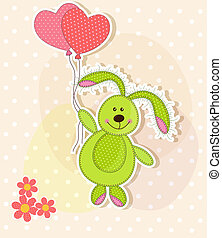 Beautiful toy bunny with hearts