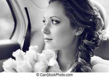 Beautiful bride woman portrait with bridal bouquet posing in...