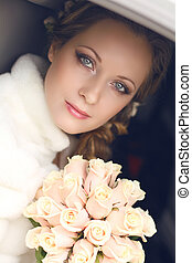 Beautiful bride woman portrait with bridal bouquet posing in her wedding day