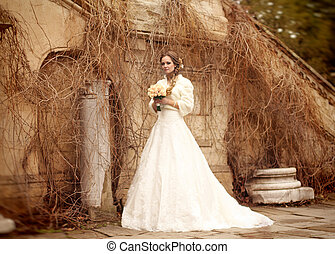 Bride beautiful woman in wedding dress - outdoor portrait