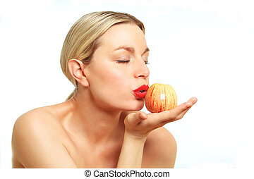 Blonde female model with Apple - A female model wearing...
