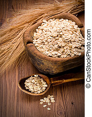 Oatmeal in  spoon - Oatmeal in old wooden spoon