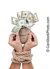 Prisoner of profit - man holding bag of money with hands...