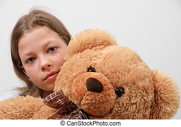 Close-up of the preteen girl with her teddy bear