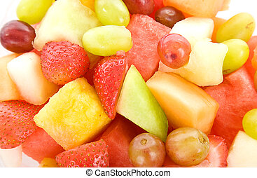 Fruit Salad Macro Background - Closeup of mixed fruit salad...