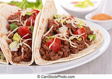 beef tacos with salad and tomato