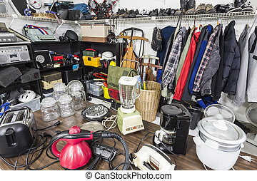Interior garage sale, housewares, clothing, slorting goods...
